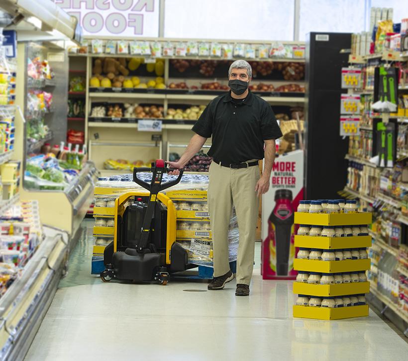 Lift Rite Yellow Edge, retail, employee walking with truck