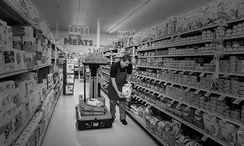 One Man Lift, Lift-Rite SpinGo being used within a grocery store.